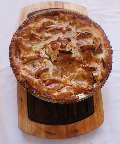 food pie on brown wood slab cake