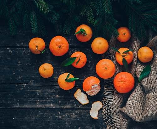 fruit 13 oranges on black textile citrus fruit