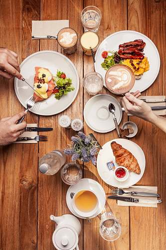 human assorted foods on plate with coffee and utensils person