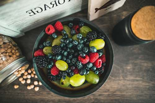 blueberry assorted fruits on gray metal bowl fruit