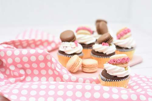 cake assorted macaroons and cupcakes on pink textile cupcake