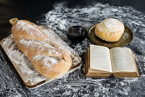 bread baked bread beside book book