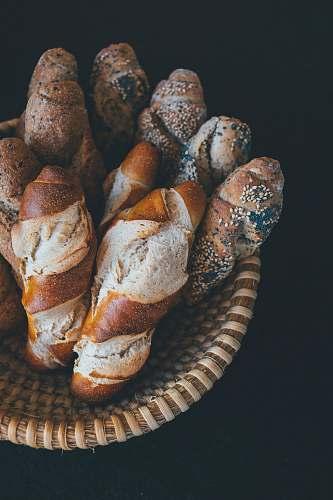 bread baked bread on brown wicker bowl bun