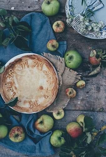 apple baked pie beside green apples apples