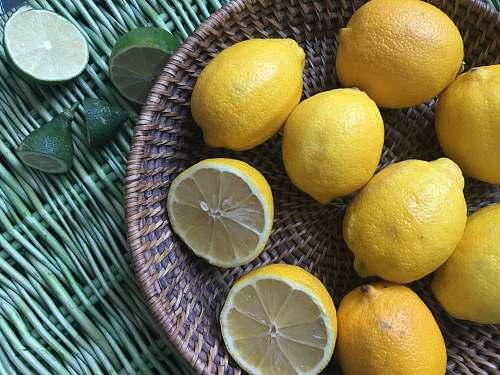 fruit basket of yellow lemons citrus fruit