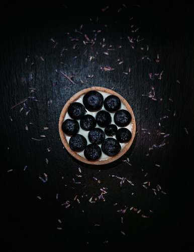 blueberry black berries in white and brown round tray fruit