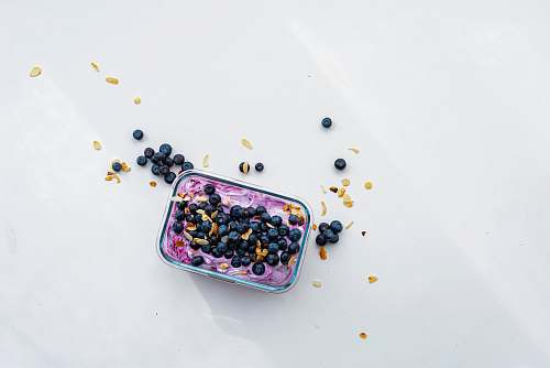 fruit black berries on pink container blueberry