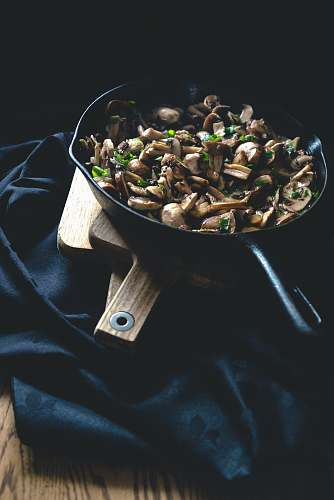 plant black frying pan with food on top bean sprout