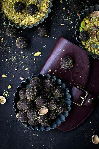 fruit bowl filled with chocolate coated nuts flora