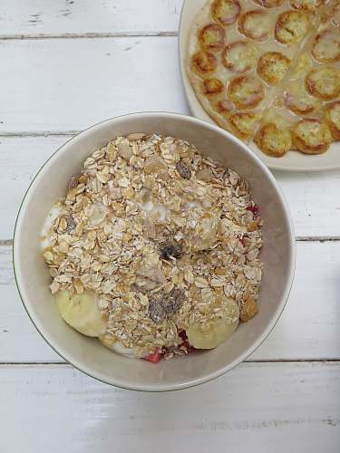 meal bowl of fruits topping with cereal oatmeal