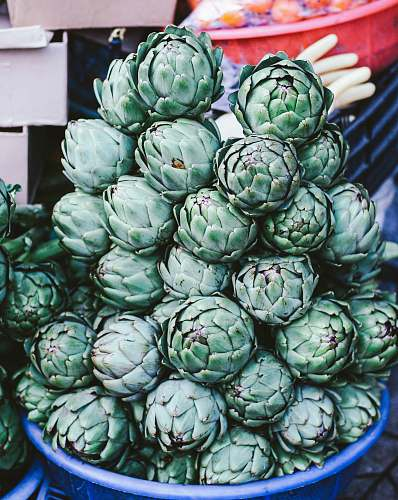 produce bowl of pine cones artichoke