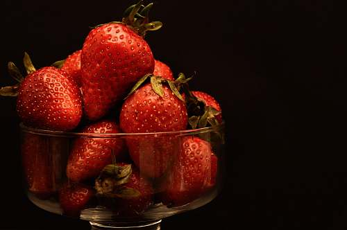 fruit bowl of red strawberries plant