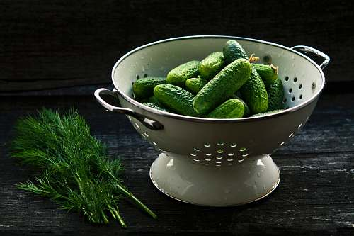 vegetable bowl strainer and pickles cucumber