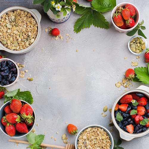fruit bowls of strawberries and oats plant