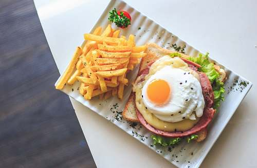 egg bread with egg and fries on plate burger
