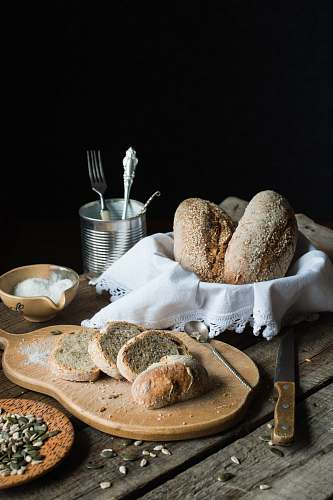 bread breads on brown chopping board bun