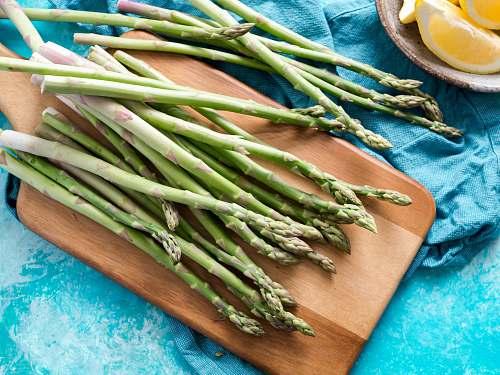 asparagus brown chopping board vegetable
