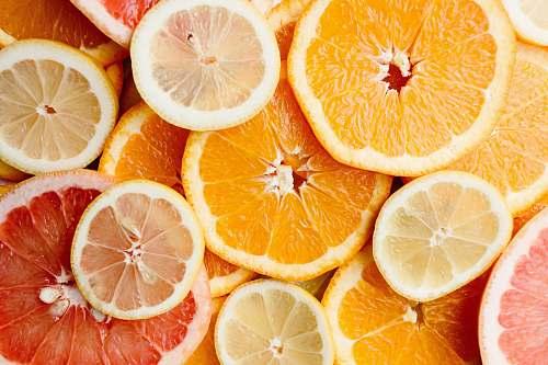fruit bunch of sliced citric fruits grapefruit