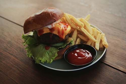 burger burger and fries with ketchup served on plate fries