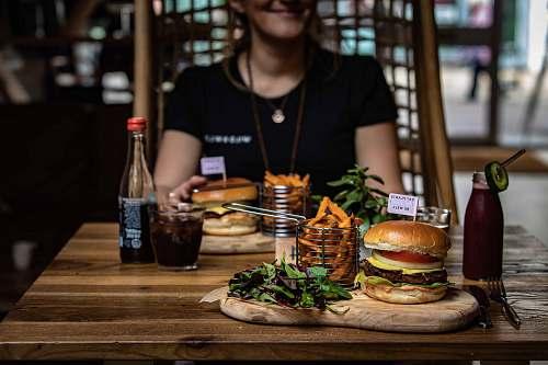 burger burger beside glass human