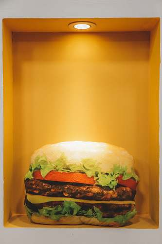 burger burger displayed on yellow container orange