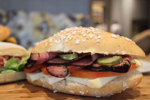burger burger on brown chopping board brown