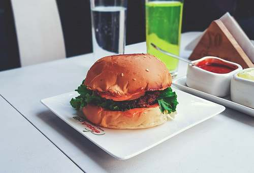 burger burger with green lettuce on white ceramic plate restaurant