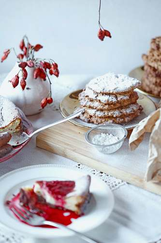 cream cake with icing on ceramic saucer dessert