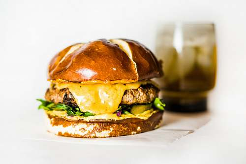burger cheese burger on white tissue beer