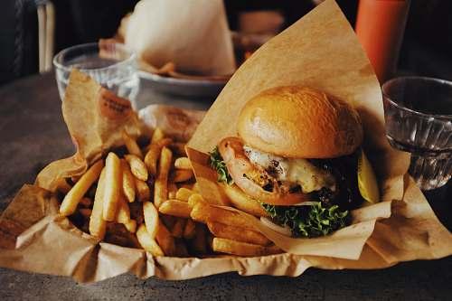 burger cheeseburger and fried potatoes person