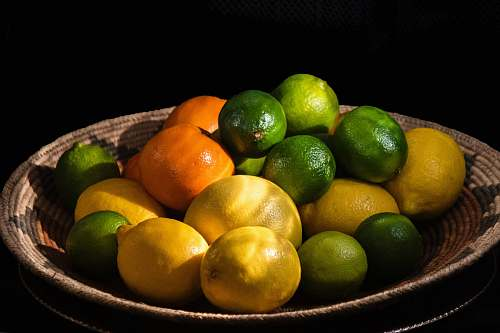fruit citrus fruits in brown bowl lime