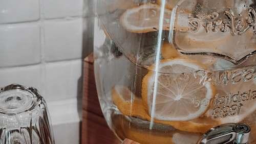 fruit citrus juice on clear glass container citrus fruit