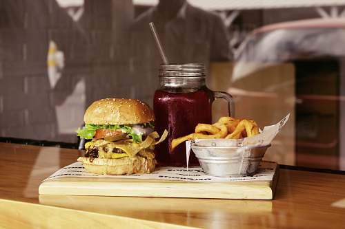 burger clear glass mason jar on brown wooden board beverage