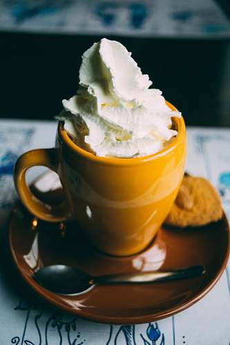 whipped cream coffee latte on ceramic mug drink