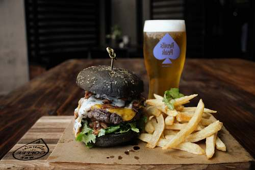 burger cooked burger and french fries beer