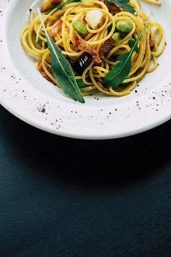 pasta cooked noodles on white ceramic bowl spaghetti