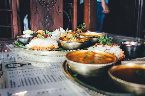 meal cooked rice and different foods in bowl on table restaurant