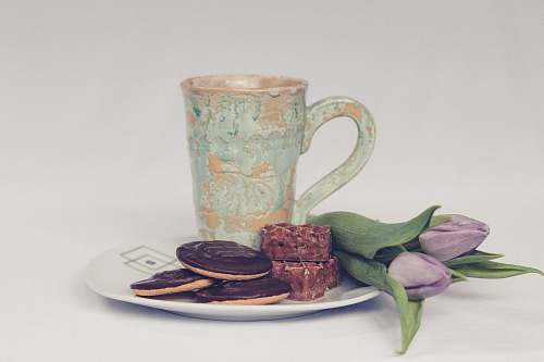 cookie cookies beside ceramic mug tea