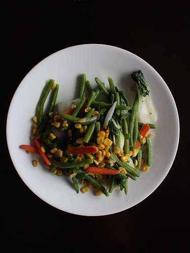 vegetable corns and sliced carrots on white plate bean