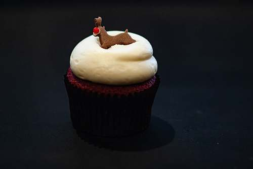 cream cupcake on black surface cupcake