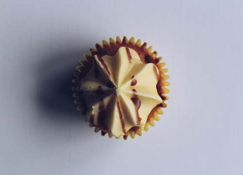 confectionery cupcake on white surface sweets