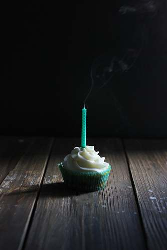 creme cupcake with candle on top dessert