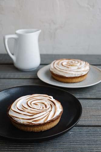 bread donut on white ceramic saucer pancake