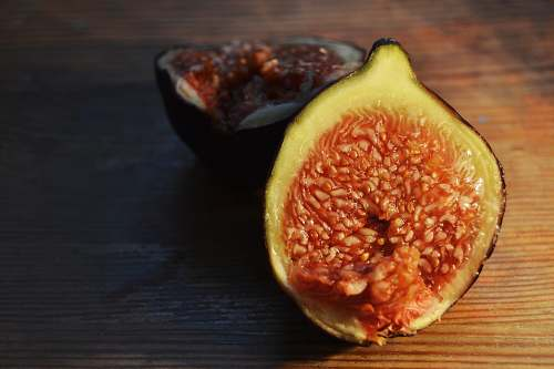 fruit fig on brown wooden surface fig