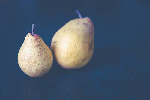 fruit filtered photography of two pear fruits pear