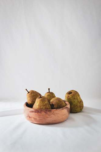 fruit five pears fruit on brown wooden bowl pear