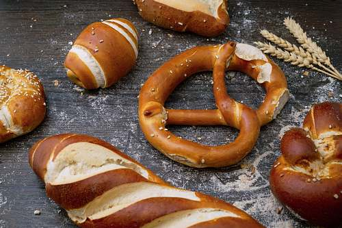 bread flat lay photography of breads pretzel