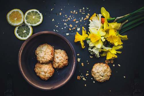 flower flat lay photography of cookies on bowl daffodil