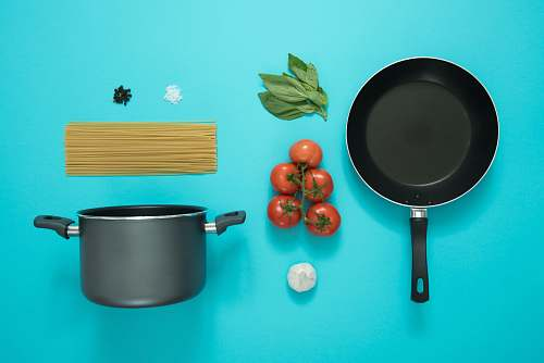 tomato flat lay photography of frying pan beside tomatoes on blue surface flora