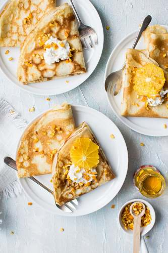honey flat-lay photography of pancake with icing cutlery